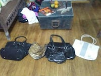 two black, brown and white leather handbags Parkersburg, 26101