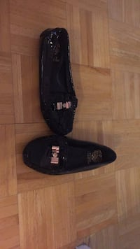 pair of black leather loafers Toronto, M6M 5B3