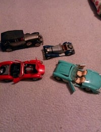 four assorted color car toys Morrisville, 19067