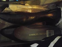 pair of black Charles Patou leather pumps with box