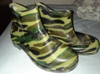 Pair of green-and-black camouflage rain boots  Hurst, 76053