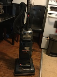 black and gray upright vacuum cleaner Toronto, M6E 2J6