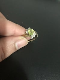 gold-colored green gemstone ring