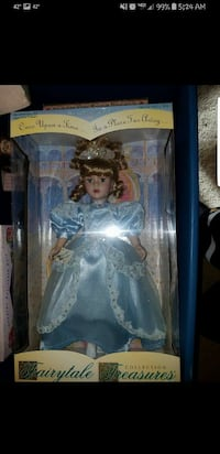 female in blue dress doll with box Waterloo