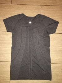 Grey Lululemon Workout shirt. Barely worn. Size 8, originally paid $80 for it.