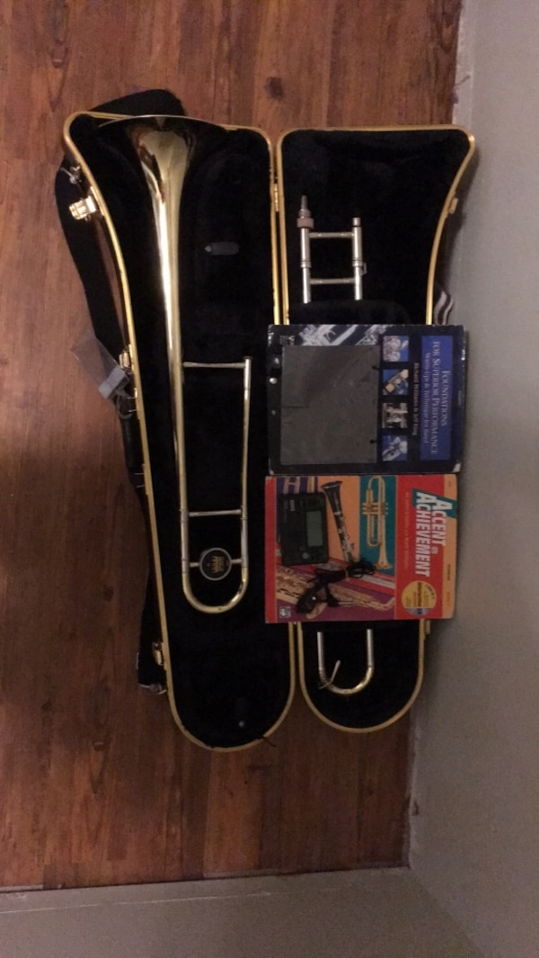 selmer king usa 606 student trombone with 2 music books, flip-folder/lyre,  tuner and pick up, tuning slide grease and cleaning brush and cloth