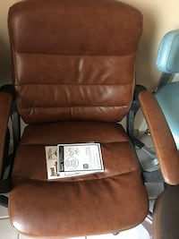 brown leather padded rolling armchair
