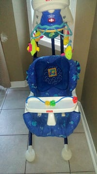 baby's blue Fisher-Price  swing