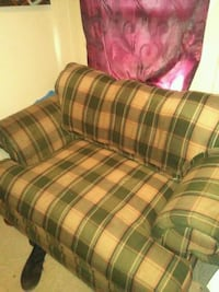 green and white plaid fabric sofa