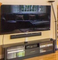 flat screen TV and brown wooden TV hutch 362 km