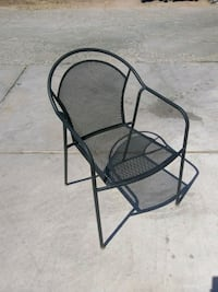 Black steel patio chair, must pick up.