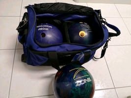three 10pin bowling balls and duo bag