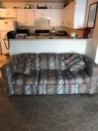 Hide a bed couch.  Good condition.  Two throw pillows.  673 mi