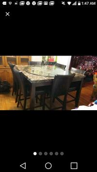 rectangular black wooden table with six chairs dining set Detroit, 48221