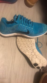 pair of blue-and-white Nike running shoes Katy, 77449