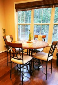 round brown wooden table with four chairs dining s Ashburn