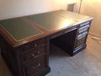 Executive desk solid wood leather top. Excellent condition. Will trade for smaller desk. Edina, 55436