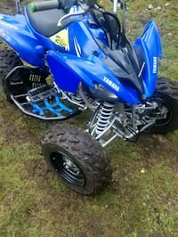 blue and black Yamaha ATV Seattle, 98198