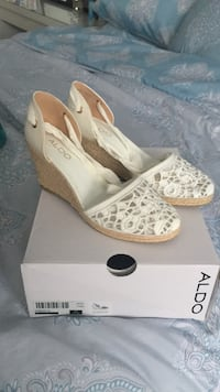 women's pair of brown-and-white close-toe Aldo wedges with box