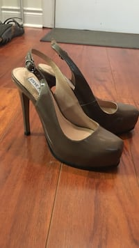 Women's pair of gray-and-beige Steve Madden leather platform heels