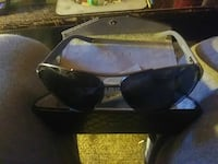 gray frame black lens Gucci sunglasses with pouch