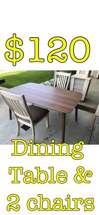Dining table and 2 chairs brand new