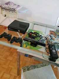 black Sony PS3 slim console with controller and game cases Toronto, M8W 3G3