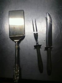 two black handled stainless steel knives 1461 mi