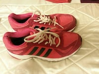 pair of red-and-black Adidas running shoes