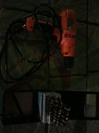 Cord drill with bits