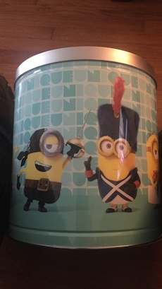Empty blue and silver Minions print tin can.