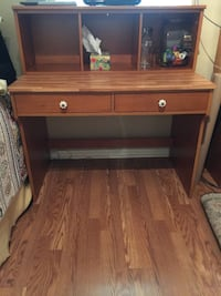 brown wooden 2-drawer desk with hutch