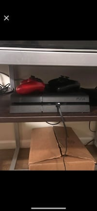 PlayStation 4 w/ 2 controllers & 3 games 385 mi