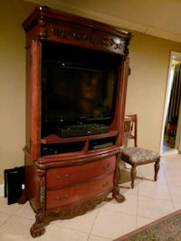 brown wooden TV hutch and flat screen TV 1042 mi