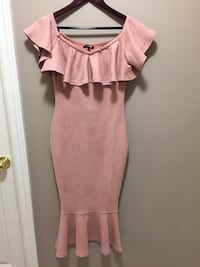 Fashion Nova dress brand new size XP small is pink rose and ultra suede material is form fitted tight
