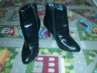 pair of Black Leather Red Bottom heeled booties St. Catharines, L2R 5L7