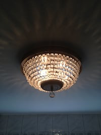 Chandelier-small crystal ceiling light. This can be mounted to your ceiling & looks beautiful. The measurements are 14 inches width and 7 inches Height. New York, 11201