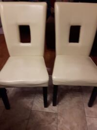 two white faux leather padded chairs North Vancouver, V7J 3N3