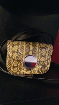 brown and yellow snakeskin flap sling bag