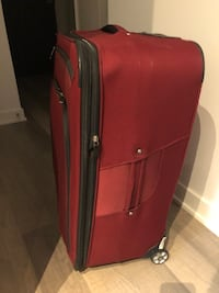 Red suitcase in good condition