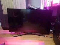 black Samsung flat screen TV 801 km