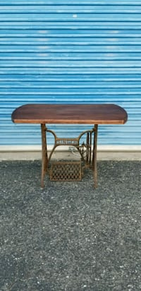Rusty Singer sewing machine table base with solid wood top.
