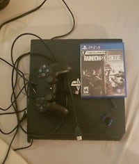 PS4 with console controller and cords  LOSANGELES