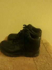 pair of mens black Nike boots Hagerstown
