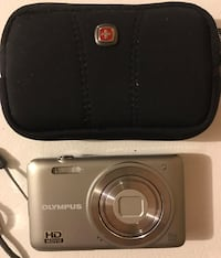 Grey olympus point and shoot camera with case