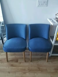 two blue padded armless chairs Toronto, M5J 2Y4