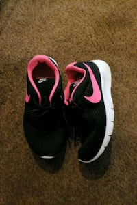 pair of black-and-pink Nike running shoes size 6y Benton