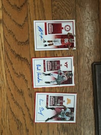 three autographed football trading cards