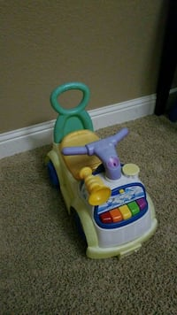Ride on and push toy. Plays music