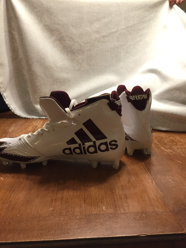 white-and-black Adidas cleats